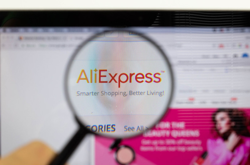 AliExpress logo on a computer screen with a magnifying glass