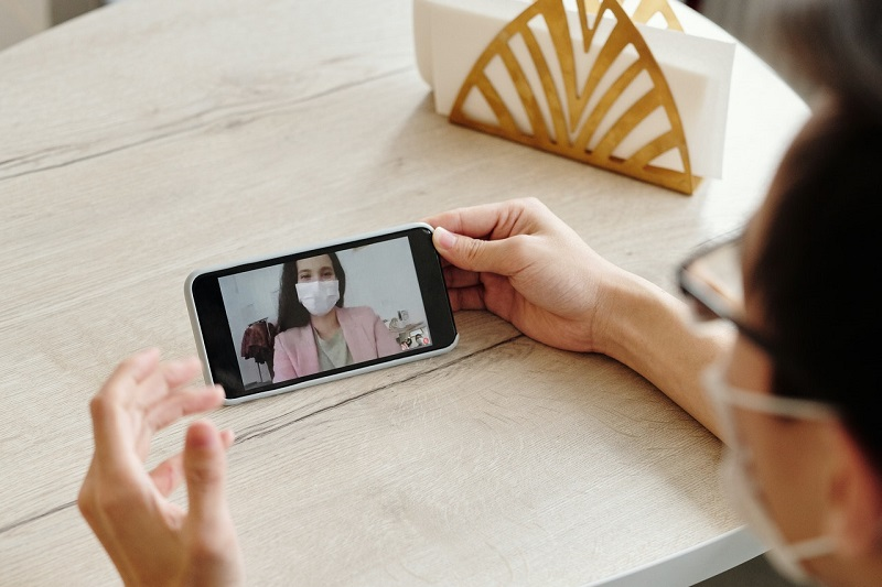 man-having-a-video-call-on-his-phone-4031820